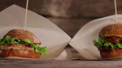 Burgers with sticks on table. Stock Footage