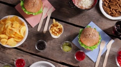 Potato chips with fresh burgers. Stock Footage