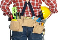 Man builder with construction tools. Stock Photos