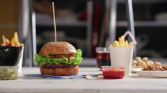 Crackers and burger on table. - stock footage