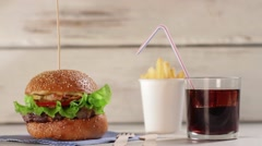 Burger with glass of cola. Stock Footage