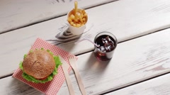 Hamburger with cutlery and drink. Stock Footage