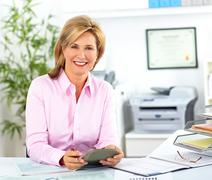 Smiling mature business woman. Stock Photos