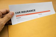 Car Insurance application form on brown envelope Stock Photos