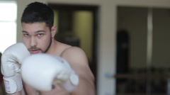 Young man boxing in gym Stock Footage