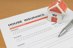 House Insurance application form with model house and pen - stock photo