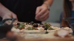 Pizza Placed onto Table with Paddle / Peel - stock footage