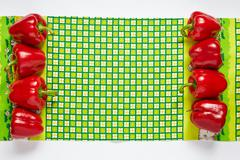 Festive frame from paprika on a green towel - stock photo