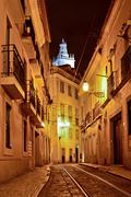 Alfama quarter at night in Lisbon, Portugal Stock Photos