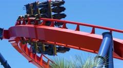 Roller coaster speeds through frame on sharp turn Stock Footage