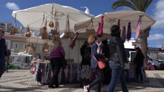 4k Tourists holiday shopping street business Lagos beach Portugal Stock Footage