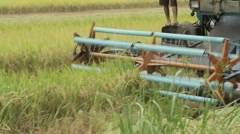 Rice harvesting machine - Close up Stock Footage