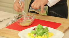 Mixing salad dressing - stock footage