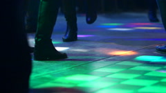 Energetic friends dancing in night club Stock Footage