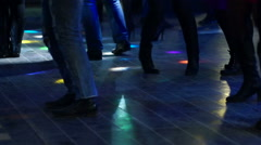Energetic friends dancing in night club Stock Footage