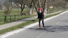 A preteen makes roller skating on a track in slow motion Stock Footage