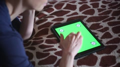 Young woman playing with Apple Ipad at home - stock footage