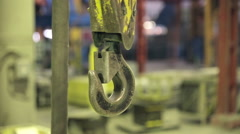 Industrial Swinging Crane Hook.  Fatory interior Stock Footage
