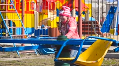 Girl sick with chickenpox riding on a swing Stock Footage