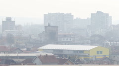 Smoggy cityscape elevated view. Smoke pollution urban enviroment. Stock Footage