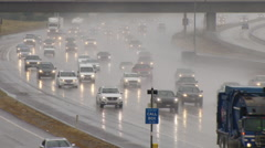 Heavy traffic during a rainstorm - stock footage