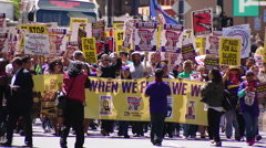 $15 per hr minimum wage crowd of protesters in the street Stock Footage