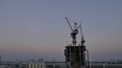 Day to night time lapse of a new condo construction with crane Stock Footage