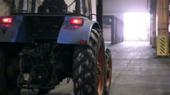 Tractor inside of a industrial factory Stock Footage
