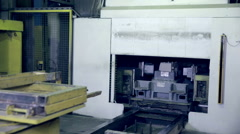 Robot making car parts at factory. Automative metal casting - stock footage