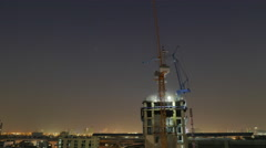 Time lapse day to night of construction crane Stock Footage