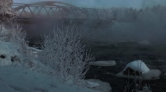 Hard frost. Beautiful snow. Sunset. Bridge. Rough River. Stock Footage