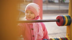attractive little girl on outdoor playground equipment - stock footage