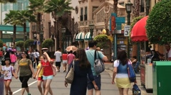 People visit Universal studio theme park at Sentosa island, Singapore. Stock Footage