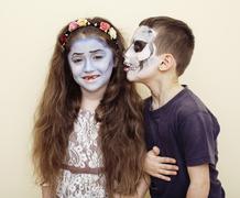 zombie apocalypse kids concept. Birthday party celebration facepaint on children - stock photo
