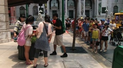 Tourists make photo at the Universal studio park at Sentosa island, Singapore. Stock Footage