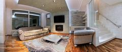 Panoramic image of modern living room interior - stock photo