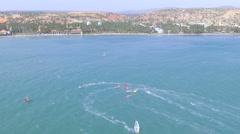 Beautiful ariel view of windsurfers sailing on blue sea Stock Footage
