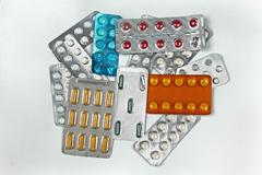 Large pile of medicine colorful pills blisters Stock Photos