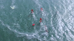 Beautiful ariel view of windsurfers sailing on blue sea - stock footage
