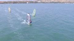 Beautiful ariel view of windsurfers sailing on blue sea - stock footage