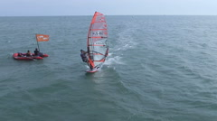 Beautiful ariel view of windsurfers sailing on blue sea Stock Footage
