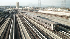 Metro cars parked on the railroad tracks by the Los Angeles River Stock Footage