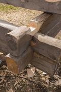 Building a house in old technology using knot timber - stock photo
