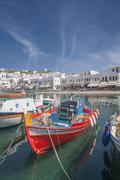 Boats anchored in Mykonos harbor, Cyclades, Greece Stock Photos