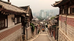 People walk by the street of Korean Bukchon Hanok Village in Seoul, Korea. Stock Footage