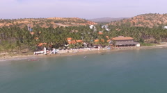 Beautiful ariel view of beach resort with palm trees and windsurfing spot. - stock footage
