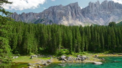 Picturesque Italian Dolomites and mountain lake Lago di Carezza - stock footage