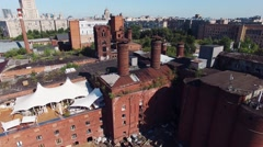 Quadrocopter shoot summer restaurant on roof of brick building. Sunny cloudless - stock footage