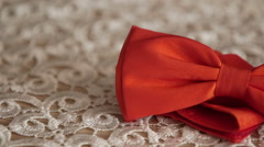 Panning shot of red bow tie on table Stock Footage
