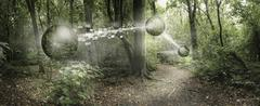 Orbs passing pixelated information in remote forest - stock photo